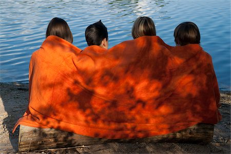 Children Sitting by Lake Stock Photo - Premium Royalty-Free, Code: 600-03799506
