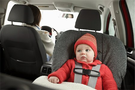 Baby in Car Seat with Mother Driving Stock Photo - Premium Royalty-Free, Code: 600-03799544