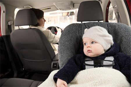 Baby in Car Seat with Mother Driving Stock Photo - Premium Royalty-Free, Code: 600-03799545