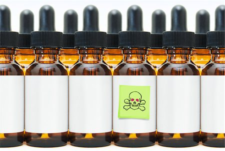 poison - Rows of Eye Dropper Bottles with One Marked Poison Stock Photo - Premium Royalty-Free, Code: 600-03814119