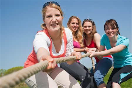 Young Women Pulling on Rope Stock Photo - Premium Royalty-Free, Code: 600-03814757