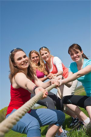 Young Women Pulling on Rope Stock Photo - Premium Royalty-Free, Code: 600-03814758