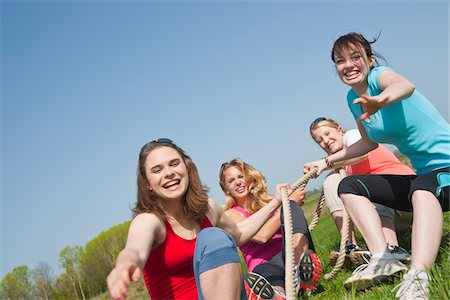 Young Women Pulling on Rope Stock Photo - Premium Royalty-Free, Code: 600-03814759
