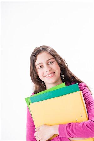 preteen girl - Girl Holding School Books Stock Photo - Premium Royalty-Free, Code: 600-03836158