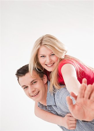 Teenage Boy Piggybacking Teenage Girl Stock Photo - Premium Royalty-Free, Code: 600-03836342