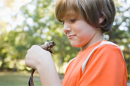 Boy Holding Frog Stock Photo - Premium Royalty-Free, Code: 600-03848736