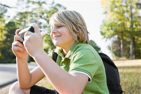 preteen  smile  one  alone - Boy using Cell Phone Stock Photo - Premium Royalty-Free, Code: 600-03848738