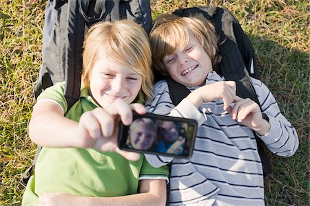 Boys taking Picture with Camera Phone Stock Photo - Premium Royalty-Free, Code: 600-03848740