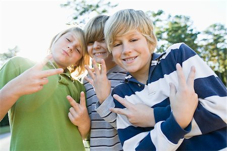 Boys Making Hand Gestures Stock Photo - Premium Royalty-Free, Code: 600-03848741