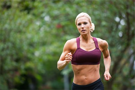 Woman Jogging through Park, Seattle, Washington, USA Stock Photo - Premium Royalty-Free, Code: 600-03849015