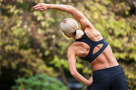 Backview of Woman Stretching after Jogging, Seattle, Washington, USA Stock Photo - Premium Royalty-Free, Code: 600-03849018