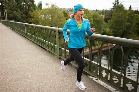 Woman Jogging across Bridge, Seattle, Washington, USA Stock Photo - Premium Royalty-Free, Code: 600-03849022