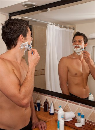 Man Shaving in Hotel Room, Reef Playacar Resort and Spa, Playa del Carmen, Mexico Stock Photo - Premium Royalty-Free, Code: 600-03849174