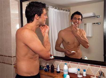 Man Shaving in Hotel Room, Reef Playacar Resort and Spa, Playa del Carmen, Mexico Stock Photo - Premium Royalty-Free, Code: 600-03849172