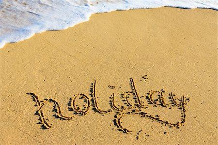 Holiday Written in Sand, Waimanoao Beach Park, Oahu, Hawaii, USA Stock Photo - Premium Royalty-Free, Code: 600-03849502