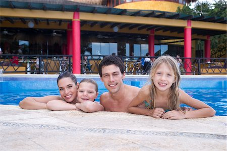 Family in Swimming Pool, Reef Playacar Resort and Spa, Playa del Carmen, Mexico Stock Photo - Premium Royalty-Free, Code: 600-03849555