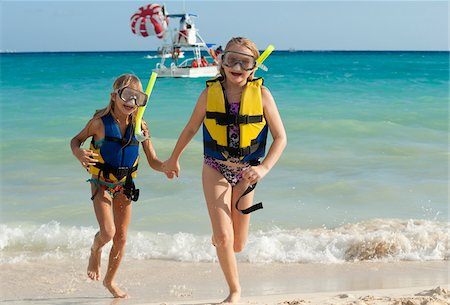 Girls in Snorkeling Gear on Beach, Reef Playacar Resort and Spa, Playa del Carmen, Mexico Stock Photo - Premium Royalty-Free, Code: 600-03849557