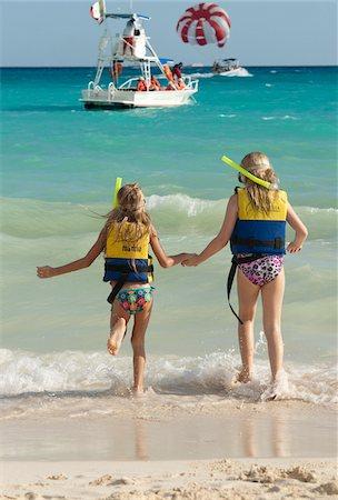 Girls in Snorkeling Gear on Beach, Reef Playacar Resort and Spa, Playa del Carmen, Mexico Stock Photo - Premium Royalty-Free, Code: 600-03849558