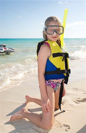 Girl in Snorkeling Gear on Beach, Reef Playacar Resort and Spa, Playa del Carmen, Mexico Stock Photo - Premium Royalty-Free, Code: 600-03849559