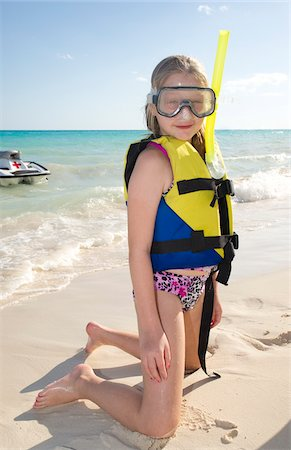 Girl in Snorkeling Gear on Beach, Reef Playacar Resort and Spa, Playa del Carmen, Mexico Stock Photo - Premium Royalty-Free, Code: 600-03849559