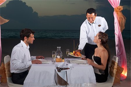 Couple Dining on Beach, Reef Playacar Resort and Spa, Playa del Carmen, Mexico Stock Photo - Premium Royalty-Free, Code: 600-03849564