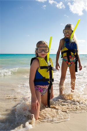 Girls in Snorkeling Gear on Beach, Reef Playacar Resort and Spa, Playa del Carmen, Mexico Stock Photo - Premium Royalty-Free, Code: 600-03849560