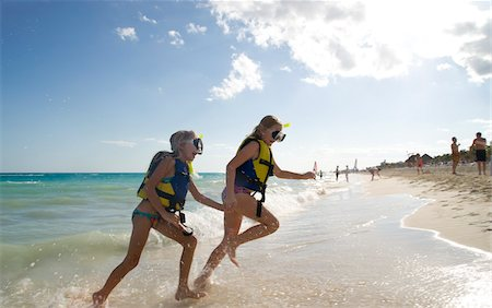 Girls in Snorkeling Gear on Beach, Reef Playacar Resort and Spa, Playa del Carmen, Mexico Stock Photo - Premium Royalty-Free, Code: 600-03849561