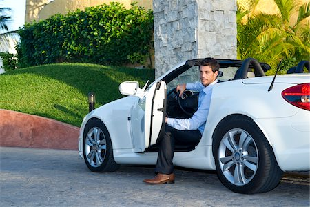 Man Getting Out of Car, Reef Playacar Resort and Spa Hotel, Playa del Carmen, Quintana Roo, Yucatan Peninsula, Mexico Stock Photo - Premium Royalty-Free, Code: 600-03849657