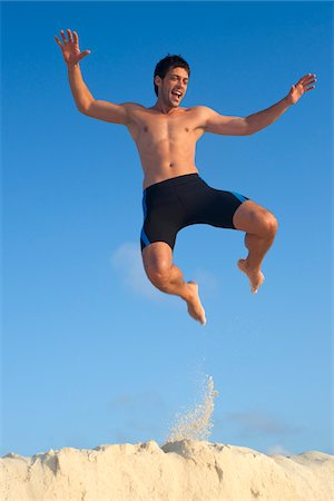 Man Jumping, Reef Playacar Resort and Spa Hotel, Playa del Carmen, Quintana Roo, Yucatan Peninsula, Mexico Stock Photo - Premium Royalty-Free, Code: 600-03849658