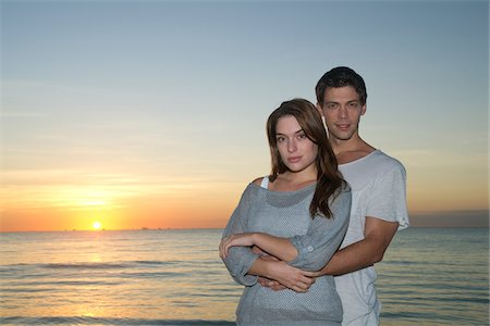 Portrait of Couple at Sunset, Reef Playacar Resort and Spa, Playa del Carmen, Mexico Stock Photo - Premium Royalty-Free, Code: 600-03849692
