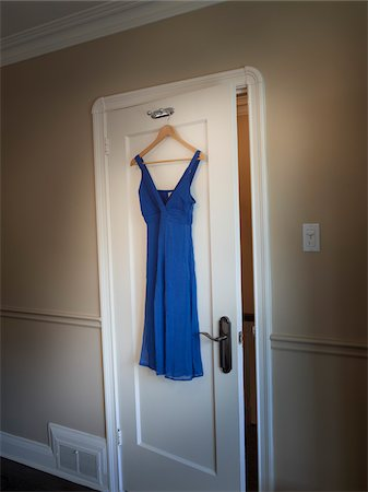 Dress Hanging on Closet Door Stock Photo - Premium Royalty-Free, Code: 600-03849756
