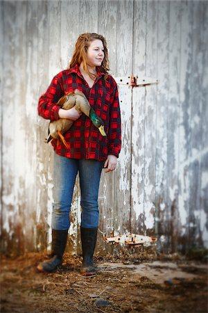 Teenage Girl holding Mallard Drake in front of Barn, Belledune, New Brunswick, Canada Stock Photo - Premium Royalty-Free, Code: 600-03849751