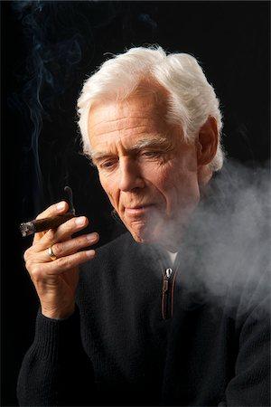 Man Smoking Cigar Stock Photo - Premium Royalty-Free, Code: 600-03865038