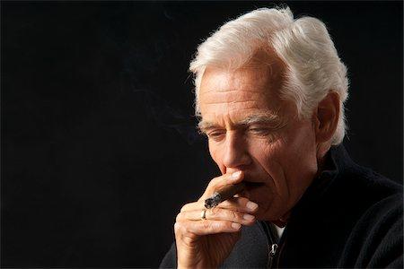 Man Smoking Cigar Stock Photo - Premium Royalty-Free, Code: 600-03865039