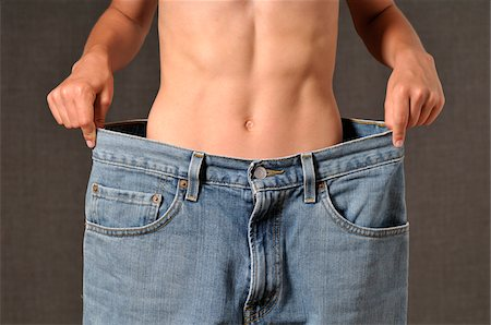 slim - Boy Wearing Large Jeans Stock Photo - Premium Royalty-Free, Code: 600-03865102
