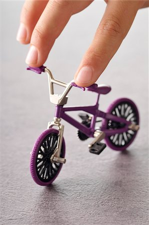 preteens fingering - Fingers Touching Miniature Bike Stock Photo - Premium Royalty-Free, Code: 600-03865103
