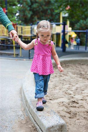 spotted - Girl Holding Mom's Hand, Washington Park Playground, Portland, Oregon, USA Stock Photo - Premium Royalty-Free, Code: 600-03865179