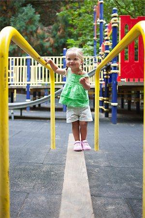 exterior bar - Girl Playing in Washington Park Playground, Portland, Oregon, USA Stock Photo - Premium Royalty-Free, Code: 600-03865173