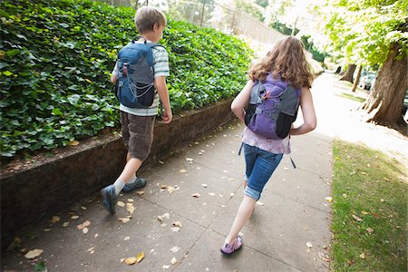Boy and Girl Walking Home from School, Portland, Oregon Stock Photo - Premium Royalty-Free, Code: 600-03865191