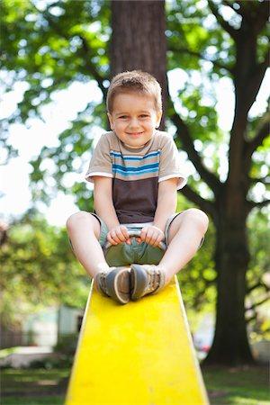 Boy Playing on Teeter-Totter, Washington Park Playground, Portland, Oregon, USA Stock Photo - Premium Royalty-Free, Code: 600-03865192