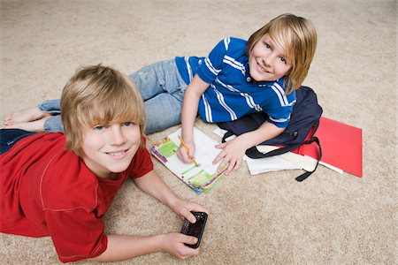 Boys Doing School Work and Using Cellular Telephone, Tallahassee, Florida, USA Stock Photo - Premium Royalty-Free, Code: 600-03865584