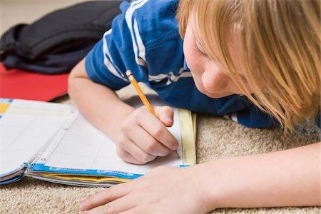 Boy Doing School Work, Tallahassee, Florida, USA Stock Photo - Premium Royalty-Free, Code: 600-03865581