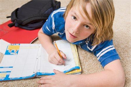 Boy Doing School Work, Tallahassee, Florida, USA Stock Photo - Premium Royalty-Free, Code: 600-03865582