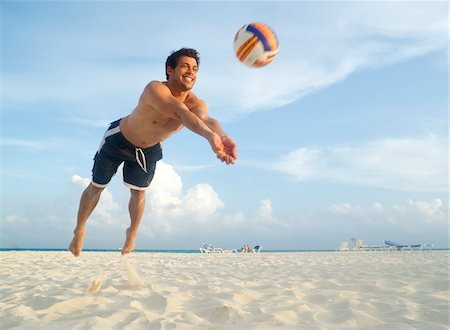 Man Playing Volleyball on Beach, Mexico Stock Photo - Premium Royalty-Free, Code: 600-03891033