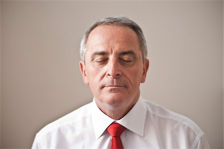 Portrait of Man with Eyes Closed Stock Photo - Premium Royalty-Free, Code: 600-03893385