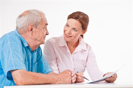Man and Woman Discussing Paperwork Stock Photo - Premium Royalty-Free, Code: 600-03893405