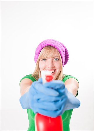 focus on background - Portrait of Girl Holding Cleaning Supplies Stock Photo - Premium Royalty-Free, Code: 600-03893417