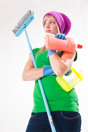 Portrait of Young Woman with Cleaning Supplies Stock Photo - Premium Royalty-Free, Code: 600-03907115