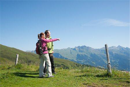 Couple Looking at View, Bernese Oberland, Switzerland Stock Photo - Premium Royalty-Free, Code: 600-03907118