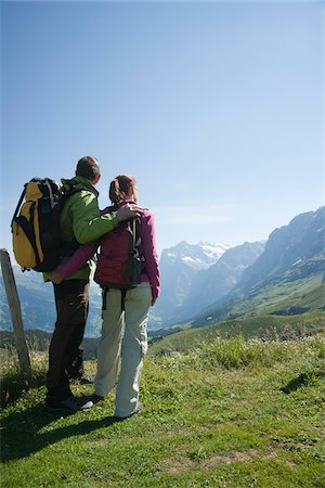Couple Looking at View, Bernese Oberland, Switzerland Stock Photo - Premium Royalty-Free, Code: 600-03907119